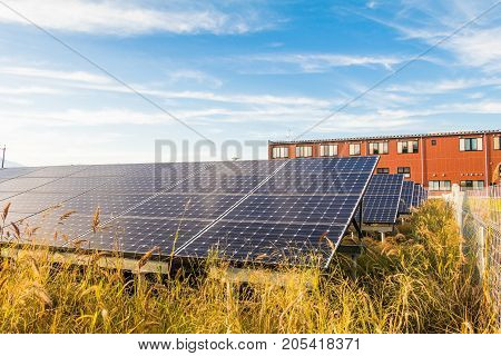 Solar power panels Photovoltaic modules for innovation green energy for life with blue sky background