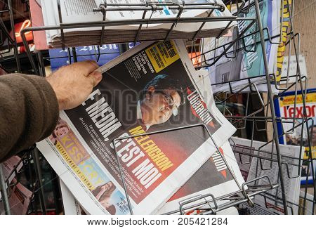 PARIS FRANCE - SEP 23 2017: Man buying latest French Liberation newspaper with Jean Luc Melenchon saying The Media is me