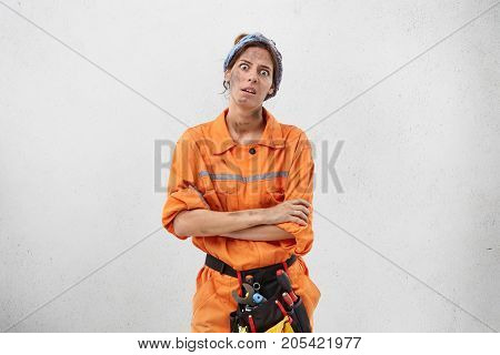 Portrait Of Discontent Fatigue Dirty Female Labour Worker Feels Bored, Does Monotonous Work All Time