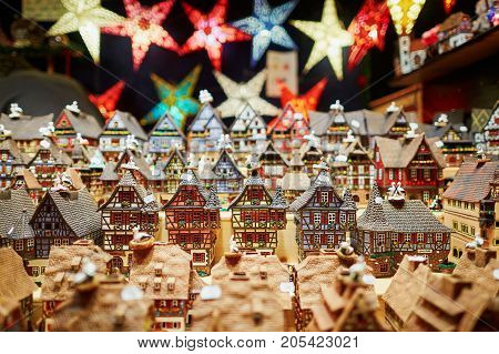Variety Of Ceramic Houses And Star Garlands At Traditional Christmas Market In Strasbourg