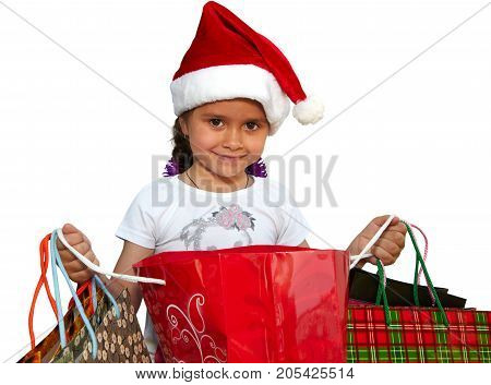 Little girl in fur-cap with shopping bags. Isolated over white background. Christmas