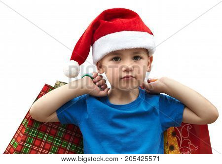 Little boy in fur-cap with shopping bags. Isolated over white background. Christmas