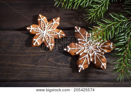 Christmas Gingerbread House Cookie  a wooden background.