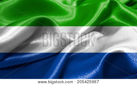 Realistic flag of Sierra Leone on the wavy surface of fabric. This flag can be used in design
