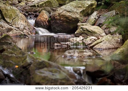 A brook in the High Fens (Hohes Venn Hautes Fagnes) in eastern Belgium. Long exposure shot. poster