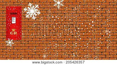 A british Royal Mail post box inset into a brick wall with snow