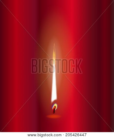 A candle flame flickering against a red background