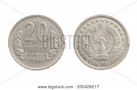 Uzbek coin on white background . Photo of an abstract texture