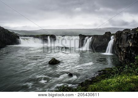 Famous Godafoss waterfall in a cloudy rainy weather