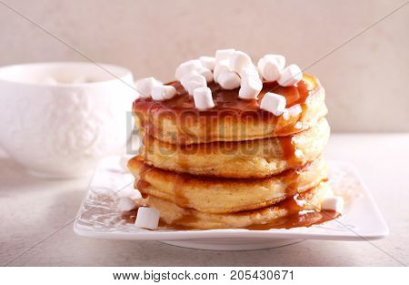 Pancakes with caramel sauce and marshmallow on top