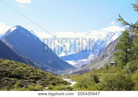 Russia, Republic of Altai. Very beautiful pictures of nature in Altai High snow-capped mountains, fast, noisy mountain rivers, beautiful meadows and fields and woods - the nature of mountain Altai