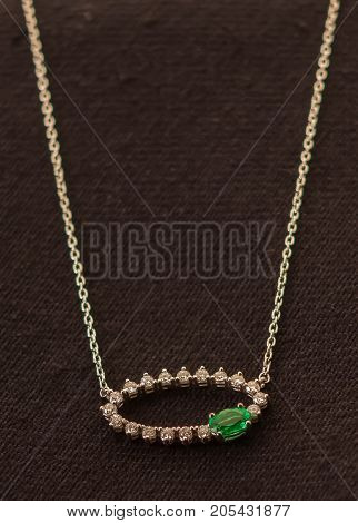 Close up of elegant diamond necklace with cloth background