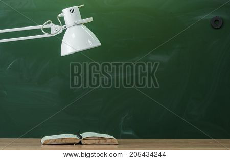 Teacher student or engineer desk table. Education background. Education concept. Book and lamp on the table.