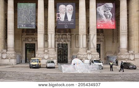 Paris; France- May 01; 2017: The Grand Palace is a majestic architectural building in the style of bos-ar. It is known as a cultural and exhibition center.Before the palace staff working