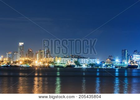 Commercial docks with light at night with a ship as bangkok