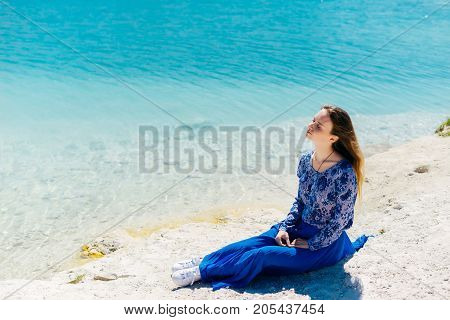 Freedom woman in free happiness bliss on beach. Smiling happy multicultural female model in blue summer dress enjoying serene ocean nature during travel holidays vacation outdoors.Copyspace water