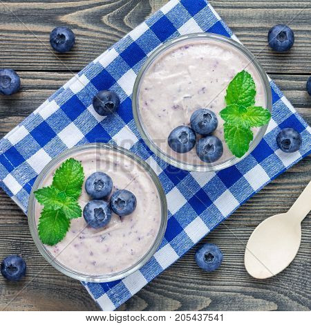 Cream cheese and blueberry mousse in a glass top view square format