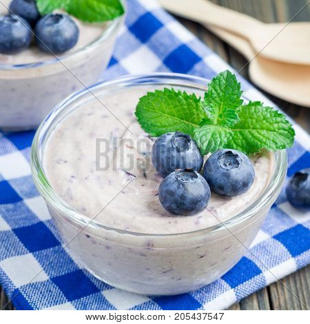 Cream cheese and blueberry mousse in glass square format