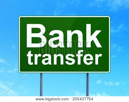 Banking concept: Bank Transfer on green road highway sign, clear blue sky background, 3D rendering