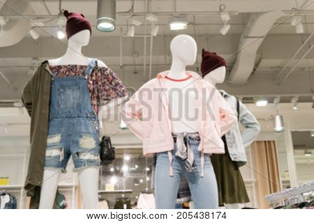 Blurry Background of Dummy clothing clothes show in the department store.