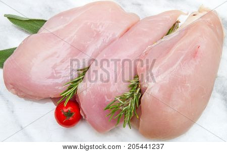 chicken breast on white plate on white background