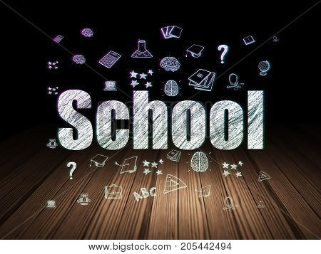 Learning concept: Glowing text School,  Hand Drawn Education Icons in grunge dark room with Wooden Floor, black background