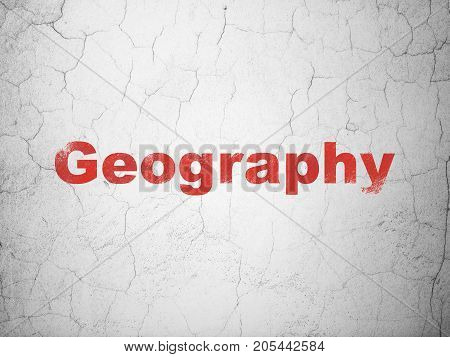Education concept: Red Geography on textured concrete wall background