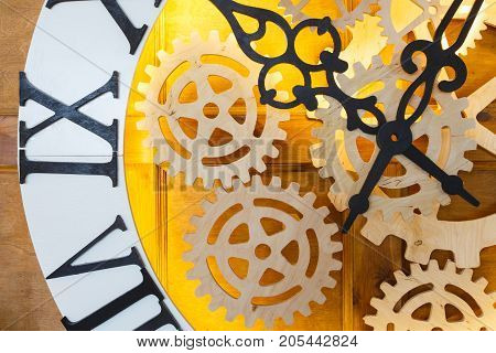 Huge fairy like clock with watch mechanism. Magical golden clock dial closeup