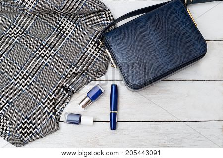 Fashion background. Dress and cosmetic products in blue color