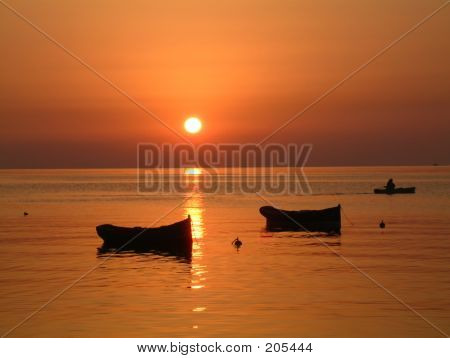 Sunrise With Boats