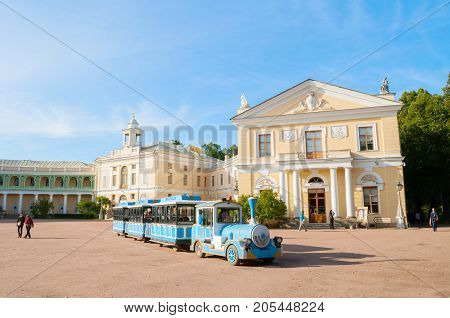 PAVLOVSK ST PETERSBURG RUSSIA - SEPTEMBER 21 2017. Pavlovsk Palace in Pavlovsk St Petersburg Russia and sightseeing vehicle with tourists