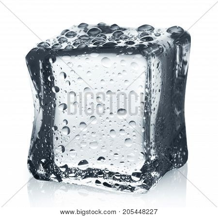 Transparent ice cube with water drops isolated on white background. Closeup of cold crystal block cutout