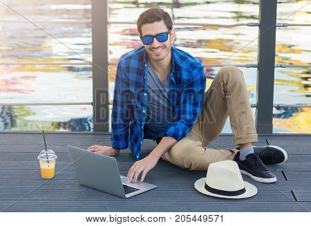 Outdoor Image Of Young Casually Dressed European Male Enjoying Leisure Time He Is Spending On Grey W
