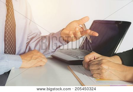 Businessman and businesswoman process. Businessman and businesswoman working the project on table.