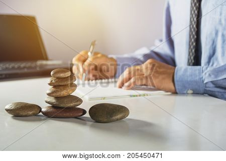 Businessman process and writing. Businessman working the project on table