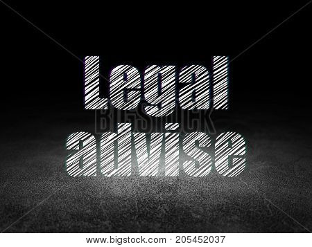 Law concept: Glowing text Legal Advise in grunge dark room with Dirty Floor, black background