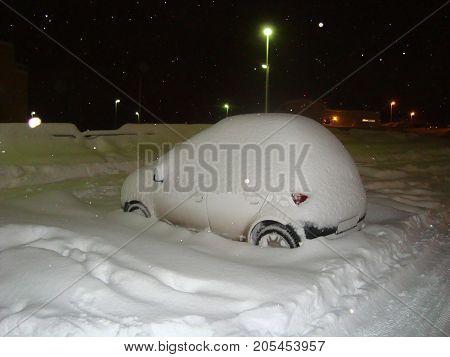 Snow cowered car during Icelandic winter in Akureyri