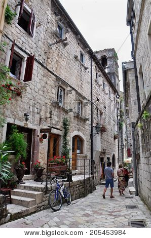 Montenegro Kotor - May 29 2014: The ancient streets of Kotor a bicycle and people