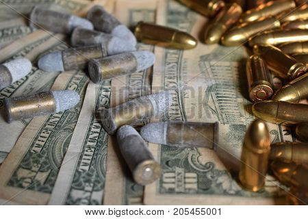 Bullet on american dollars gunpowder with gunpowder. Background money and bullets
