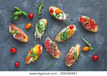 Traditional spanish tapas on dark background. Flat lay top view