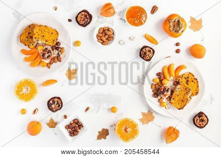 Table served for thanksgiving dinner. Autumn food on white background. Flat lay top view copy space