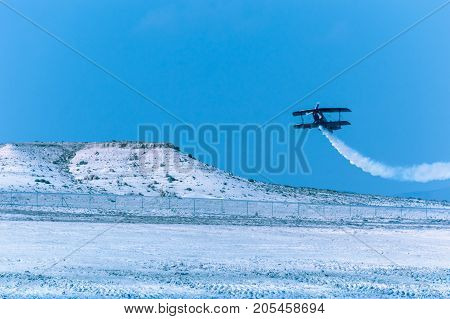 Sivrihisar Eskisehir Turkey - September 17 2017: Sivrihisar Airshows (SHG) small aviation event displayed in SUSHM. Ali Ismet Ozturk flying with his aerobatic plane