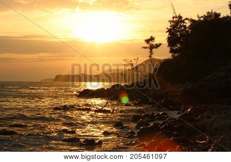 seascape, sea sunset, the sun and the sea, the sea in the Sunny glare, yellow light and the sea, sea cliff