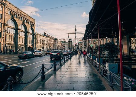 St. Petersburg, Russia - Circa June 2017: The historical center of St. Petersburg, Nevsky Prospekt, pavement, cafes, urban traffic, ancient buildings