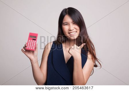 Asian Woman Thumbs Up With Calculator.