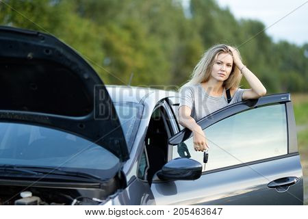 sad girl car standing outside broken car