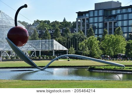 MINNEAPOLIS, MINNESOTA - JUL 26: The Spoonbridge and Cherry at the Minneapolis Sculpture Garden in Minnesota, as seen on July 26, 2017. It is one of the largest urban sculpture gardens in the country.