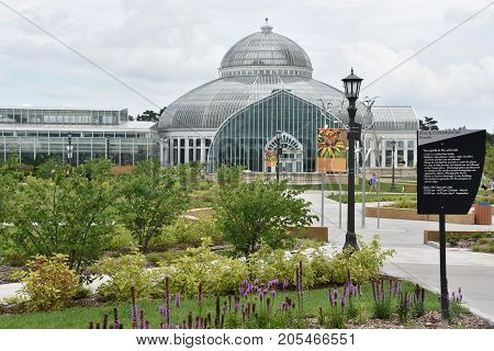 ST PAUL, MINNESOTA - JUL 26: Marjorie McNeely Conservatory at Como Park in St Paul, Minnesota, as seen on July 26, 2017. It was first opened to the public in November 1915.