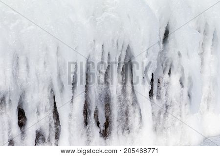 Background Of Bright Transparent Icicles In The Sunlight