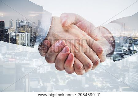 Side view and close up of professional handshake on abstract modern downtown city background. Deal concept. Double exposure